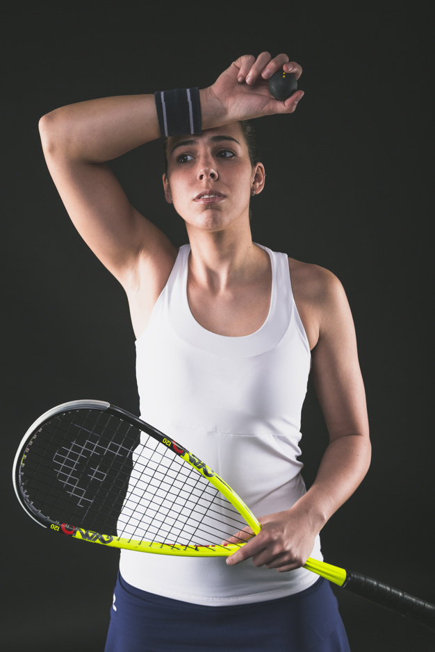 squash-player-drying-sweat-with-wristband_23-2147601829.jpg#asset:959